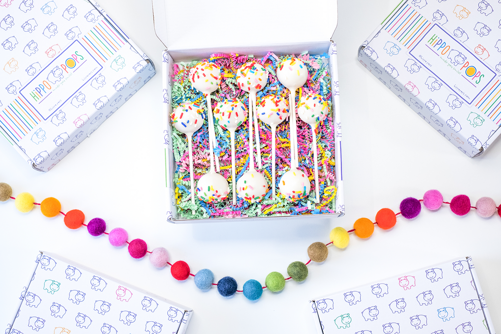 Image showing HippoPops gift box with cake pops and colorful crinkle paper