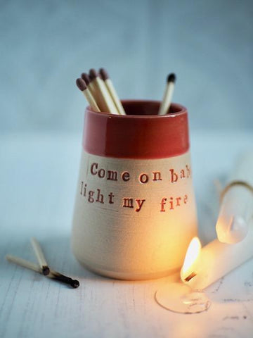 matchpot with red top and words 'come on baby light my fire'