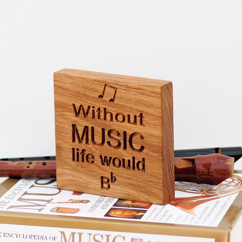 oak block engraved with 'Without Music Life would Be Flat'
