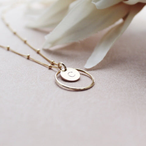 Gold necklace with personalised initial surrounded by gold circle