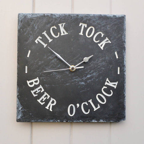 square slate clock with silver handles and white writing reading 'Tick Tock Beer O'Clock'