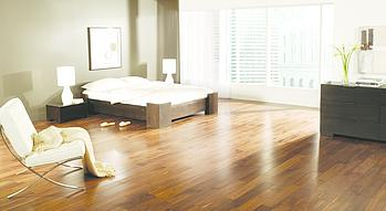 shiny hardwood floors in a bright spacious bedroom