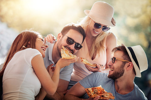 People enjoying pizza without the worry of food intolerances