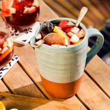 Load image into Gallery viewer, Turquoise jug with sangria on a wooden table.
