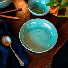 Load image into Gallery viewer, Turquoise pasta bowl on a dark table with navy napkin and soup spoon.