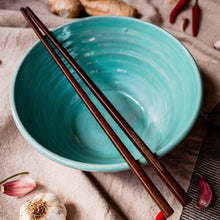 Load image into Gallery viewer, Turquoise bowl with chopsticks from above on a cream tablecloth with garlic, chilli and ginger scattered around.