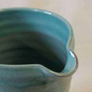 Rim and spout of a turquoise jug