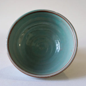 Mini turquoise bowl from above on a white background