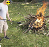 Man using black torch starting camp fire