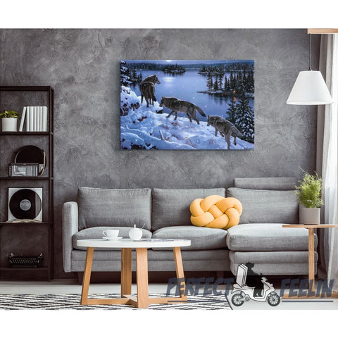 Wolf-pack Walking through Snow at Night Framed Canvas Photo