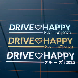 Kuruzu drive happy die cut that comes in 3 colors: white, gold metallic and oil slick. Safe to apply onto clean car windows.