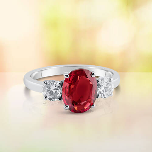 Ruby Engagement Ring with Two Side Stone Round Diamonds