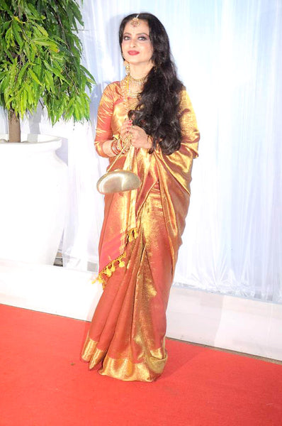 Rekha at a wedding reception