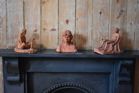 THREE CLAY FIGURES