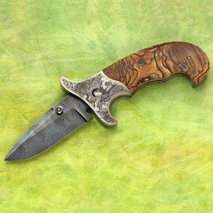 Engraved zebra jasper folding knife