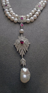 Natural double-strand freshwater pearl and ruby and white colored cubic zirconia inset silver necklace