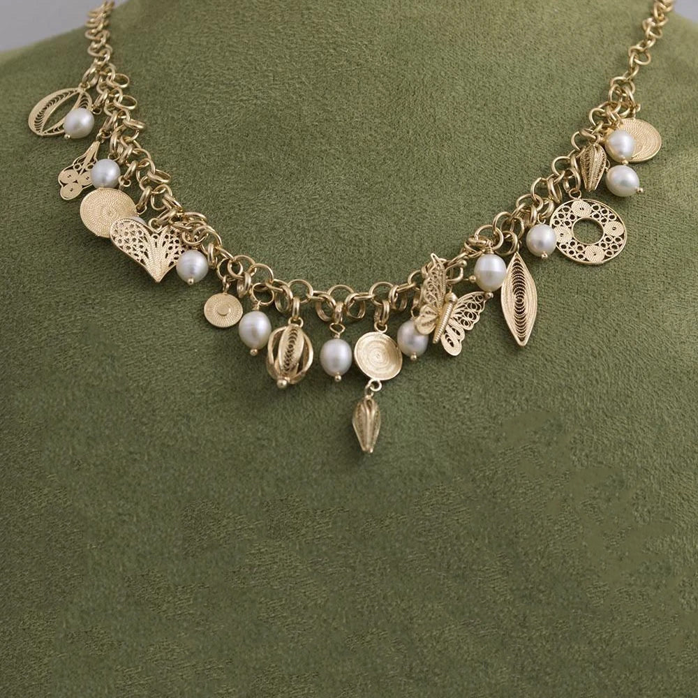 Pearl and charm necklace