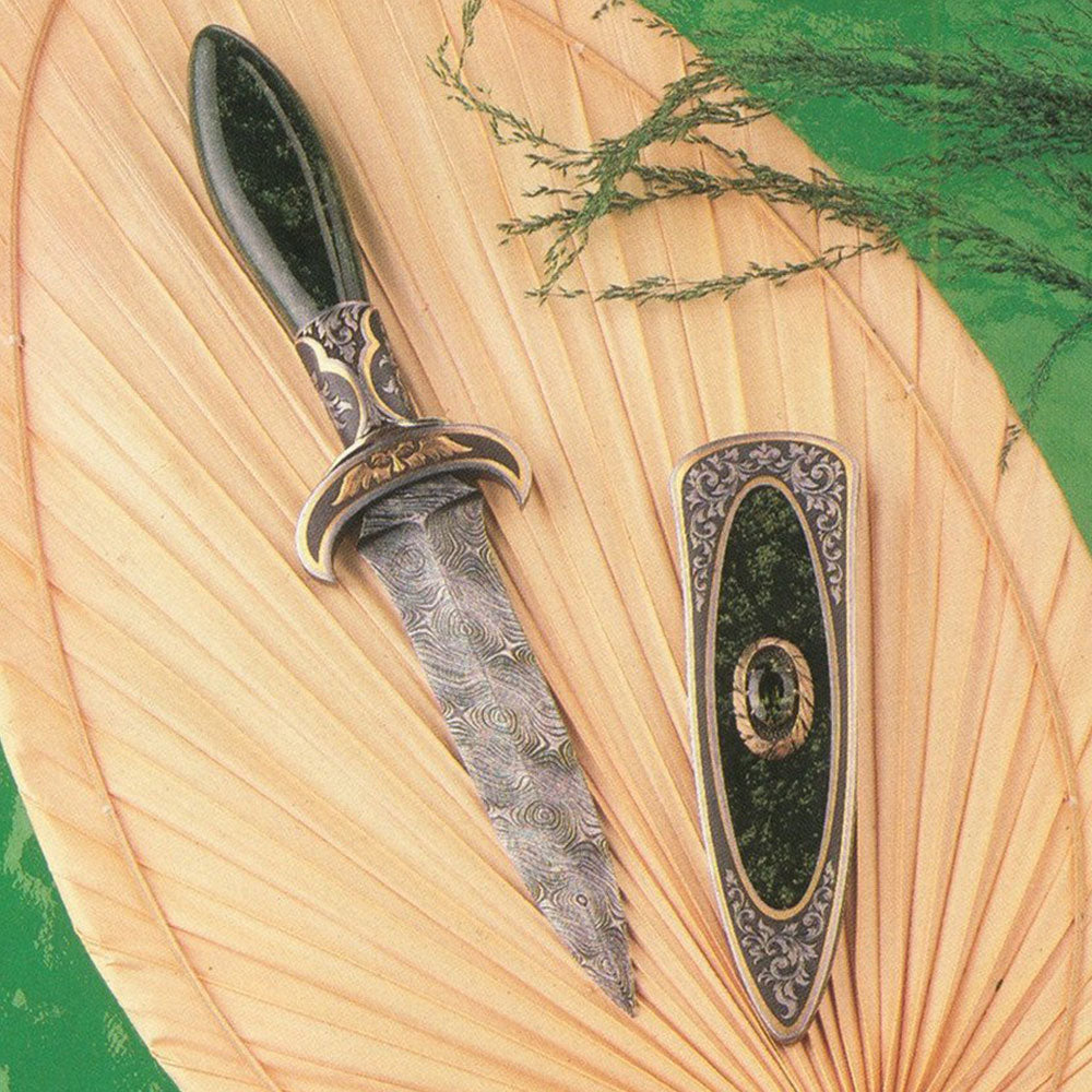 Engraved jade handled boot knife and matching scabbard