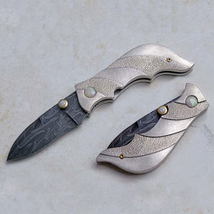 Carved silver folding knife