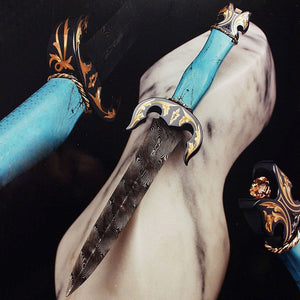 Engraved/gold inlaid turquoise handled dagger