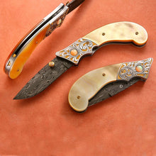 Load image into Gallery viewer, Engraved gold mother of pearl folding knife