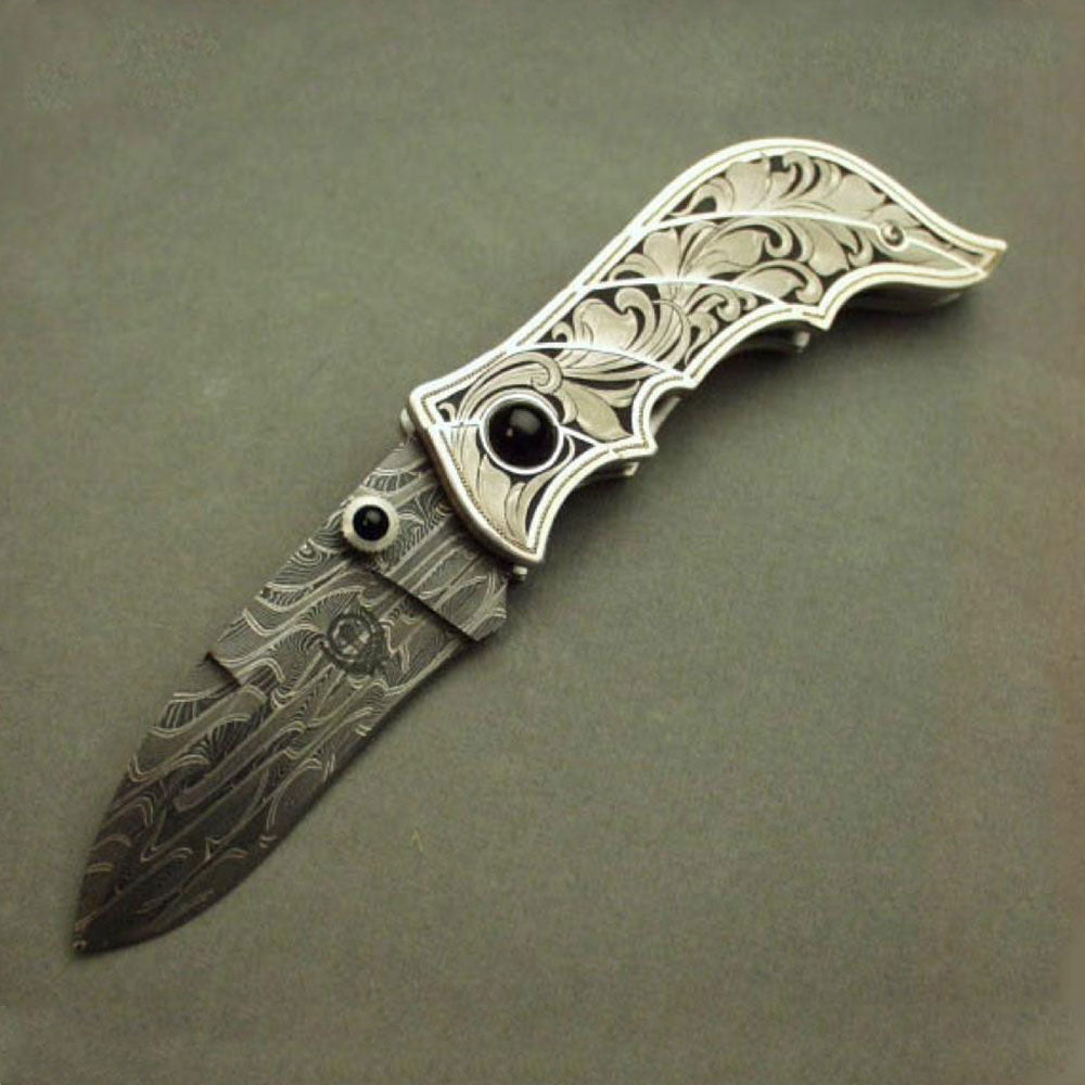 Engraved carved silver folding knife