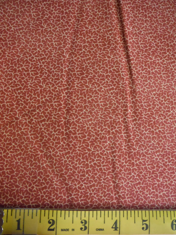 Pink fabric with beige cracked design