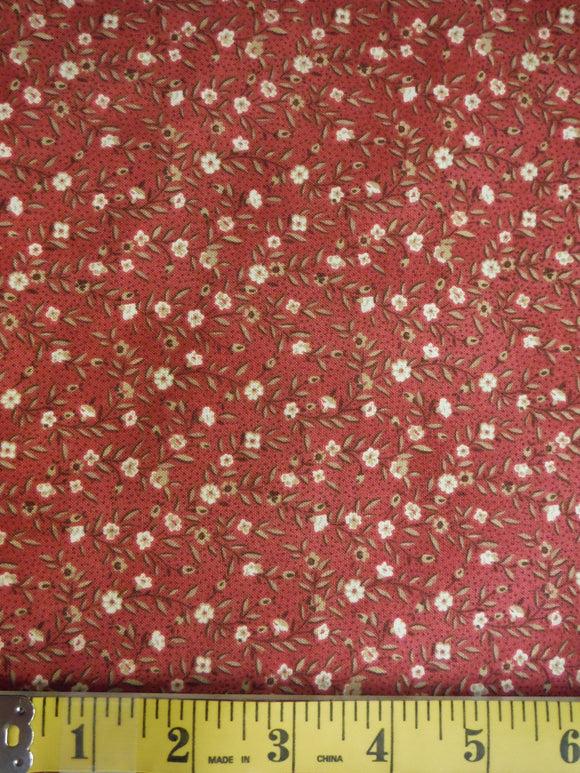 Dark red fabric with small white flowers