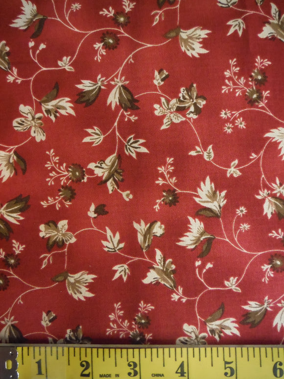 brown flower vines on dark red fabric