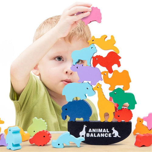 boy stacking animal balancing blocks