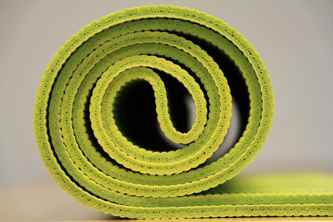 green rolled yoga mat