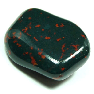 squarish shaped smooth stone black with red spots