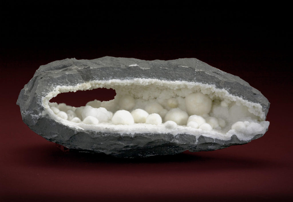 white unpolished rock gray exterior red background