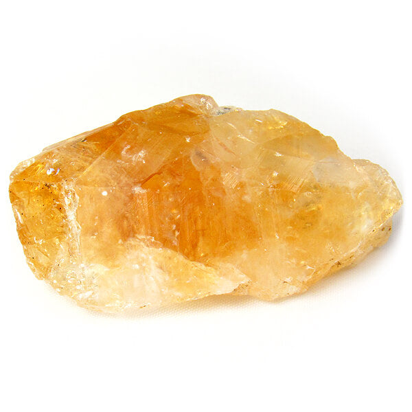 piece of raw yellow crystal rock close up view