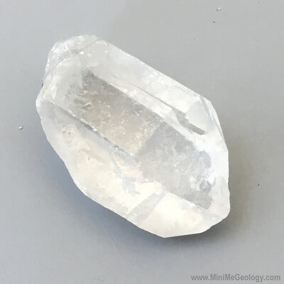 clear crystal rock gray background close up view