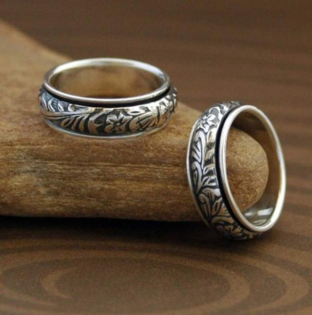 two pieces of rings with engraved floral design