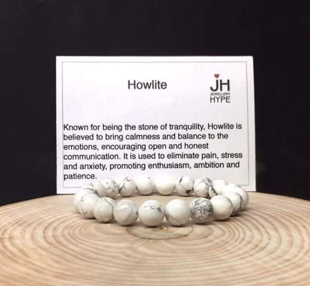 White Howlite Gemstone Anxiety and Healing Bracelet placed on a wooden surface