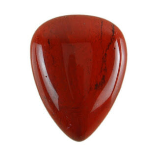 red tear drop smooth gem white background close up view