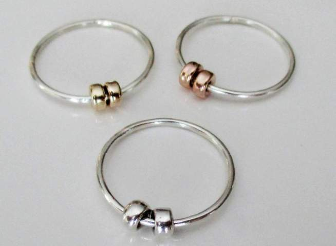 three pieces of silver rings with two circle beads