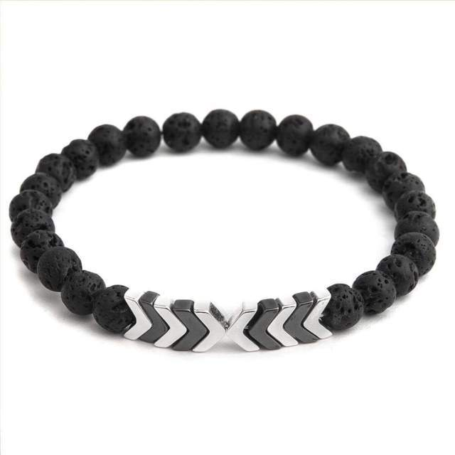 bracelet made up of black circular beads on a white background