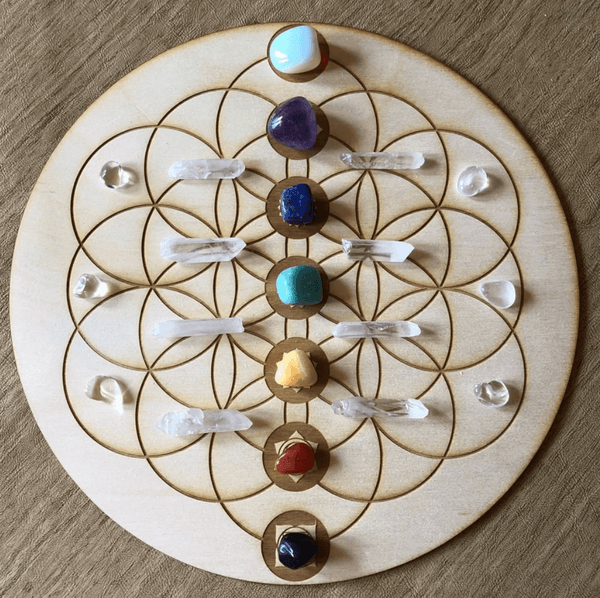 purple blue green white yellow red gem stones clear crystal arranged in a circle grid