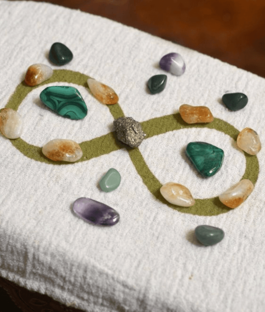 different types of orange green purple black crystals and smooth stones infinity symbol