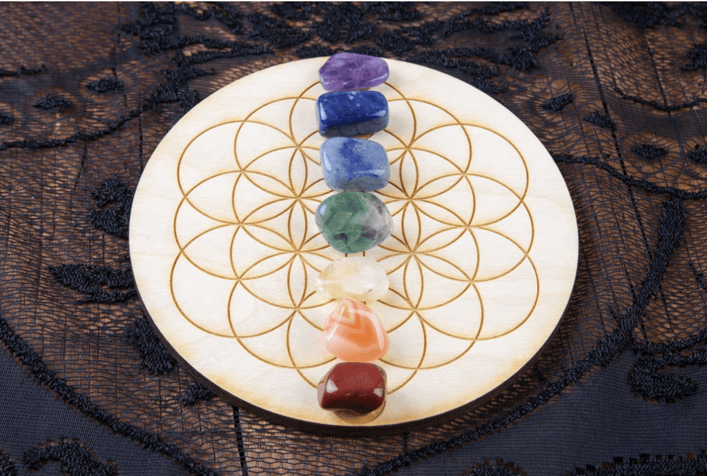 purple blue green white yellow red gem stones arranged in a circle grid