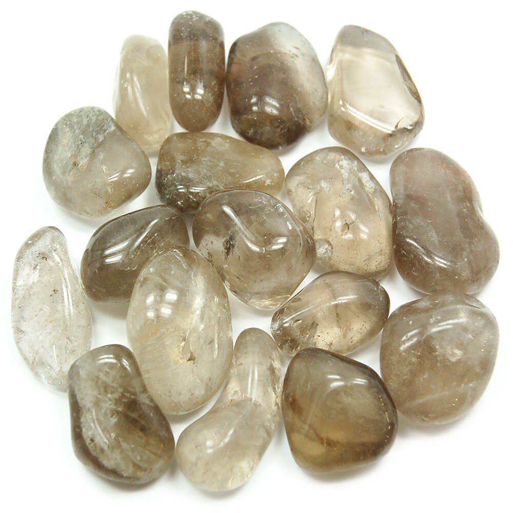 many pieces of smooth white and smoky stones close up top view
