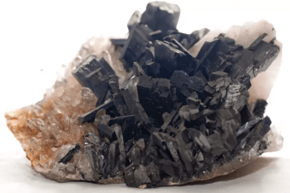 black and peach colored raw crystal rock close up view