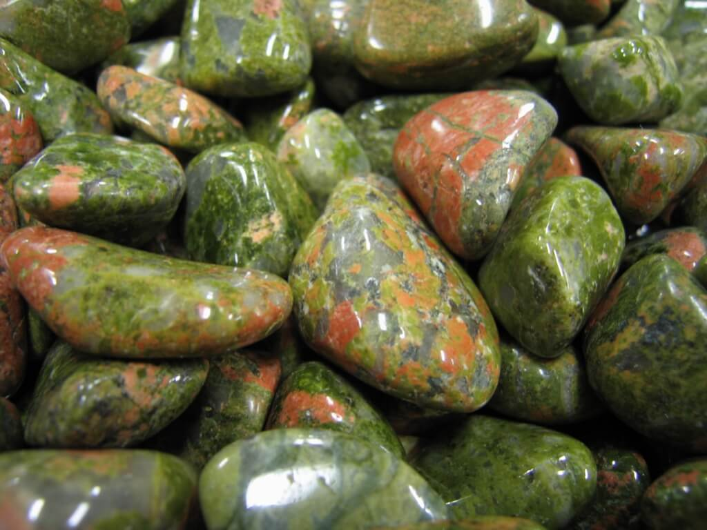 pieces of green smooth stone close up view details