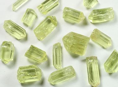 pieces of small yellow green crystal rock on a white background