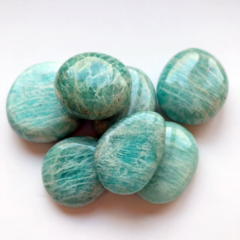 seven pieces of smooth polished turquoise colored stones