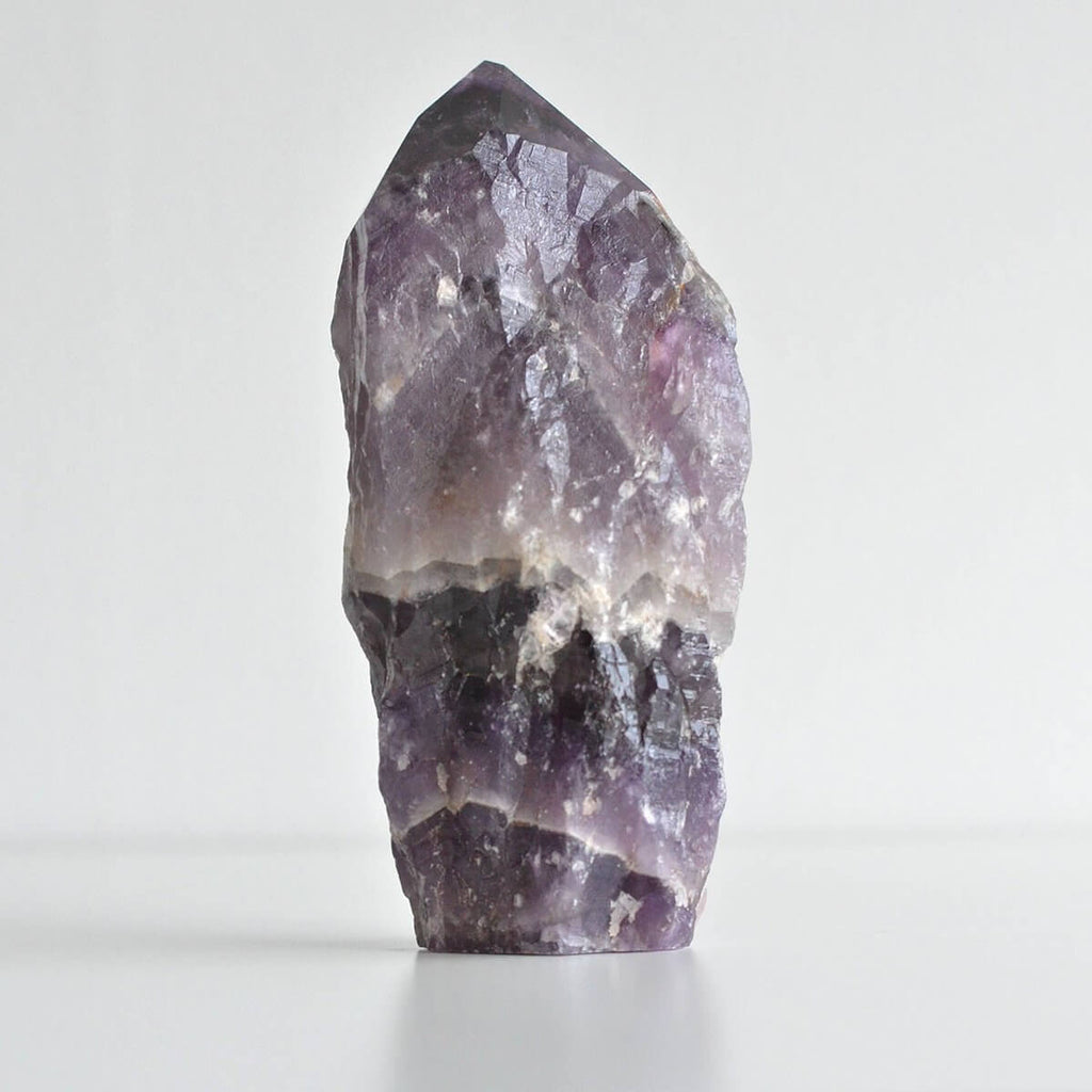 one large piece of purple unpolished crystal rock