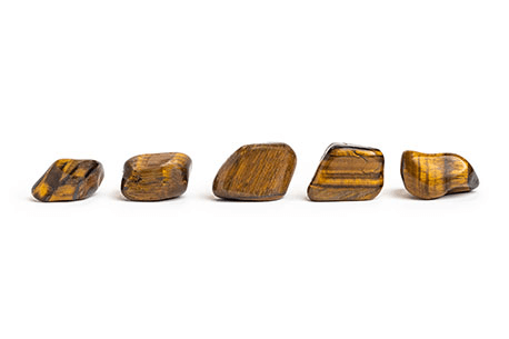 five pieces of irregular cube shape yellow with brown patterns smooth stones